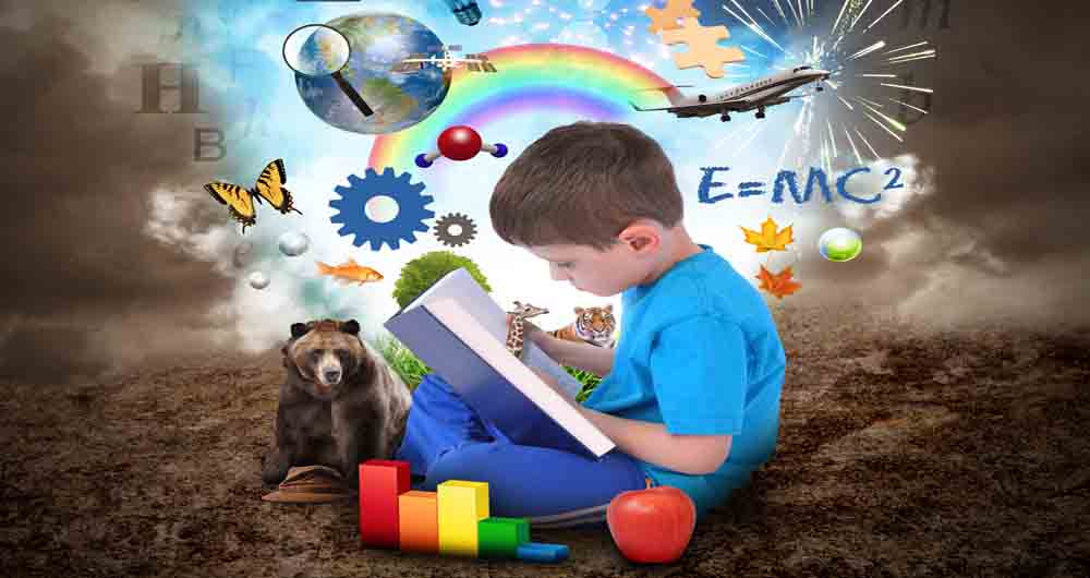 A young boy is reading a book with school icons such as math formulas, animals and nature objects around him for an education concept.