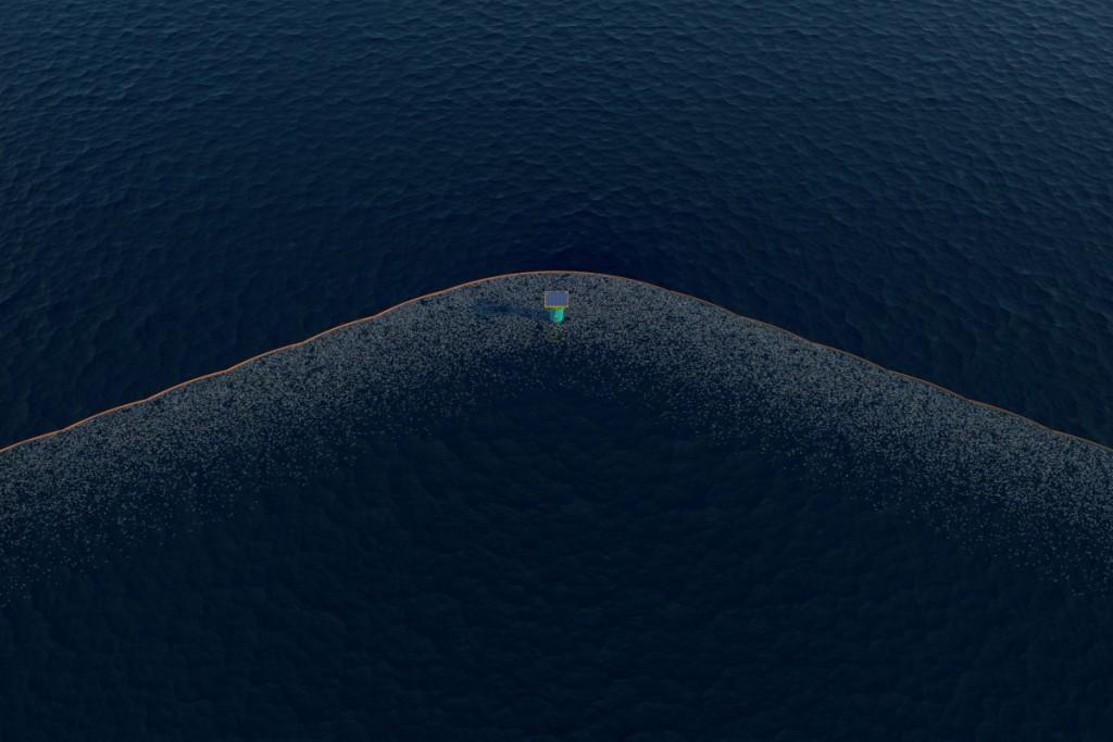 سیستم پاکسازی اقیانوس که از مرکز V عکس برداری شده و تجمع پلاستیک ها را نشان می دهد.