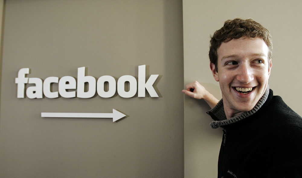 FILE - In this Feb. 5, 2007 file photo, Facebook CEO Mark Zuckerberg smiles in this office in Palo Alto, Calif. Zuckerberg turns 28 on Monday, May 14, 2012. He's considerably younger than the average FORTUNE 500 CEO, of course. But while some investors worry that Zuckerberg is too young to lead Facebook as a public company, experts point out that Bill Gates, Steve Jobs and Michael Dell were in their 20s when their companies had IPOs. (AP Photo/Paul Sakuma, File)