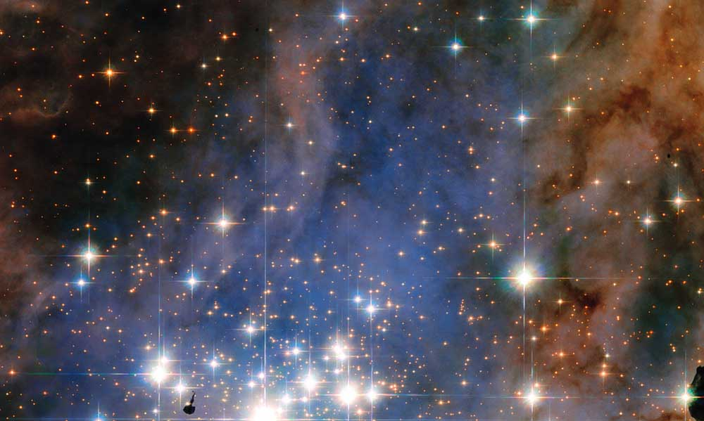 This NASA/ESA Hubble Space Telescope image features the star cluster Trumpler 14. One of the largest gatherings of hot, massive and bright stars in the Milky Way, this cluster houses some of the most luminous stars in our entire galaxy.