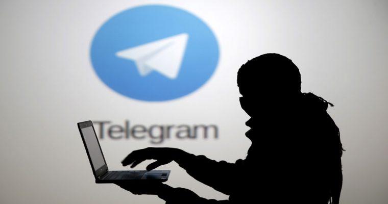 silhouette-man-lap-top-front-telegram-logo