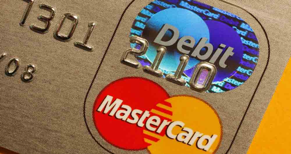 FILE - In this April 29, 2008 file photo, a MasterCard is seen  in Boston. Credit card and global payments processor MasterCard Inc. said Friday, May 1, 2009, its first-quarter profit fell 18 percent from the year-ago period that included a special gain on the sale of an investment. Its earnings still topped analysts' expectations.  (AP Photo/Bill Sikes, file)