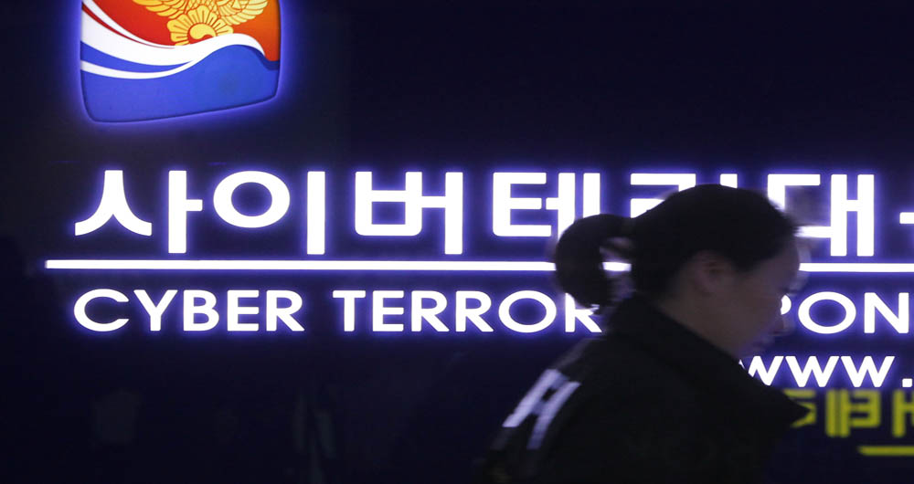 SEOUL, SOUTH KOREA - MARCH 21:  A South Korean police officer from Digital Forensic Investigation walks past at Cyber Terror Response Center at National Police Agency on March 21, 2013 in Seoul, South Korea. A cyber attack on the computer networks that run three South Korean banks, two broadcasters and an internet service provider in South Korea yesterday has been traced to an IP address in China, despite many experts suspecting the attacks to originate in North Korea. Officials noted that while the attack was traced to an IP address it China may have originated elsewhere and been routed through the country to disguise the attackers.  (Photo by Chung Sung-Jun/Getty Images)