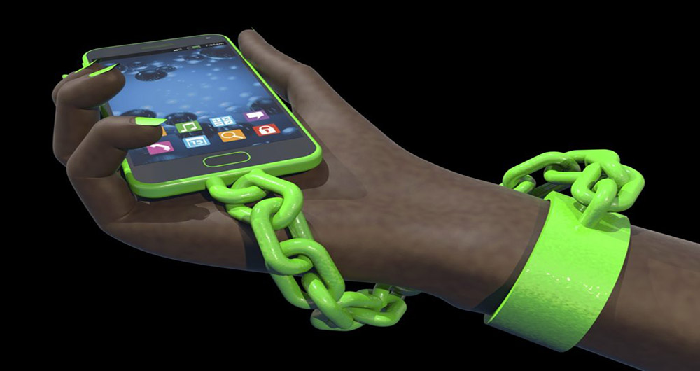 Smart phone addiction concept. Human hand chained to a generic smart phone, high-quality 3D render. Green smart phone body, nail polish, and chain, with African hand. Fictitious smart phone is a unique design, created and modelled entirely by myself. Metaphor for increasing reliance on technology and connectivity.