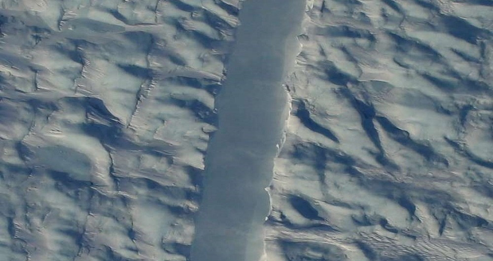 NASA just snapped the first photos of a mysterious crack in one of Greenland's largest glaciers